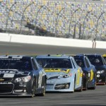 Cars sit on pit road during NASCAR Sprint Cup Series pre-season testing at Daytona Int'l Speedway on Thursday. (NASCAR Photo)