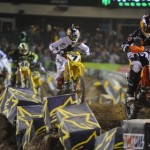 Ryan Dungey (5) leads James Stewart during Supercross competition at Angels Stadium Jan. 19. (Feld Entertainment photo)