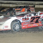 Michael Lake (27), at 11 years old, became the youngest driver ever to qualify for a NeSmith Chevrolet Dirt Late Model Series feature race on Tuesday at Bubba Raceway Park in Ocala, Fla.. Here he battles Jeremy Shaw for position. (Al Steinberg Photo)