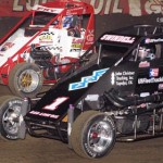 Sammy Swindell (1) drives under Ned Fry en route to victory in Wednesday's Chili Bowl River Casino Qualifying Night in Tulsa, Okla. (Frank Smith Photo)