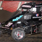 Kevin Swindell charged to victory in the Vacuworx Invitational Race of Champions, bypassing J.J. Yeley on the last lap to win the race. (Frank Smith Photo)