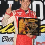 Kyle Larson stands in victory lane after winning the first Chili Bowl preliminary Tuesday night in Tulsa, Okla. (Frank Smith Photo)