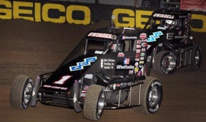 It was father vs son, (Sammy Swindell (1) leads his son Kevin Swindell), early in the 2013 Chili Bowl  Midget Nationals A-Main in Tulsa, Okla. (Frank Smith Photo)