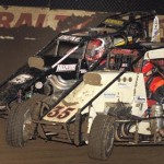 Billy Pauch Jr., Andrew Deal and Mario Clouser go three-wide during early Chili Bowl heat race action Thursday night in Tulsa, Okla. (Frank Smith Photo)