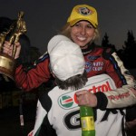 Courtney Force gets a big hug from her father John Force after winning the NHRA Funny Car division championship during the O'Reilly NHRA Winternationals at Auto Club Raceway at Pomona. (NHRA Photo)