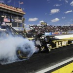 Tony Schumacher performs a burnout at Firebird Int'l Raceway in Chandler, Ariz., on Sunday. He went on to win his first NHRA Top Fuel Wally of the 2013 season. (NHRA Photo)