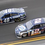 Jimmie Johnson (48) and Brad Keselowski battle for the race lead late in Sunday's Daytona 500. (HHP/Alan Marler Photo)