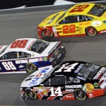 Dale Earnhardt Jr. (88), Tony Stewart (14) and Joey Logano battle during Saturday's NASCAR Sprint Cup Series Sprint Unlimited at Daytona Int'l Speedway. (HHP/Alan Marler Photo)