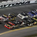 Ty Dillon (3) and James Buescher (31) lead the NASCAR Camping World Truck Series field out of turn four early in Friday's season opener at Daytona Int'l Speedway. (HHP/Brian Lawdermilk Photo)