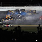 A big pack of trucks collide in the middle of turns three and four during Friday's NASCAR Camping World Truck Series opener at Daytona Int'l Speedway. (HHP/Brian Lawdermilk Photo)