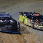 Dennis Erb Jr. (28) battles Scott Bloomquist during Friday's Lucas Oil Late Model Dirt Series event at East Bay Raceway Park. (Rick Schwallie Photo)