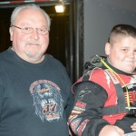 Driver Michael Lake (right) and car owner and grandfather Bobby Lake get ready to hit the track. Earlier in the week, Michael Lake became the youngest driver to qualify for a NeSmith Chevrolet Dirt Late Model Series feature. (Al Steinberg Photo)