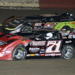 Don O'Neal (71) and Scott Bloomquist spent most of Tuesday's Lucas Oil Late Model Dirt Series event battling for the lead, with Bloomquist eventually winning the event at East Bay Raceway Park. (Al Steinberg Photo)
