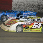 Brandon Mitchell (64) and Brandon Sheppard during Wednesday's Lucas Oil Late Model Dirt Series feature at East Bay Raceway Park. (Al Steinberg Photo)