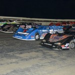 World of Outlaws Late Model Series competitors go four-wide during the parade laps Friday evening at Bubba Raceway Park in Ocala, Fla. (Al Steinberg Photo)