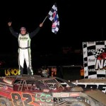 Jacob Poel stands on the roof of his UMP Modified in victory lane at Volusia Speedway Park. (Hein Brothers Photo)