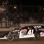 NASCAR star Ty Dillon passes under the checkered flag to win the third UMP modified feature held during the Triple 20s Tuesday at Volusia Speedway Park. (Hein Brothers Photo)