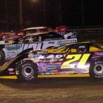 Billy Moyer (21), Casey Roberts (101) and Tim McCreadie during Wednesday's UMP Late Model feature at Volusia Speedway Park. (Hein Brothers Photo)