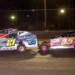 Randy Chrysler (21), Stewart Friesen (85), and Francois Bernier battle during Wednesday's Super DIRTcar Series big-block modified feature at Volusia Speedway Park. (Hein Brothers Photo)