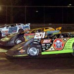 Scott Bloomquist (0), Billy Ogle Jr (201) and Jimmy Mars battle for the same piece of real estate during UMP Late Model action at Volusia Speedway Park Wednesday. (Hein Brothers Photo)