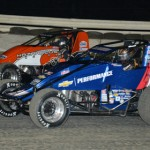 Bryan Clauson (20) works his way under Coleman Gullick during USAC AMSOIL National Sprint Car Series competition at Bubba Raceway Park in Ocala, Fla. (Al Steinberg Photo)