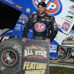 Donny Schatz stands in victory lane Friday night at Bubba Raceway Park in Ocala, Fla., Friday after winning the UNOH All Star Circuit of Champions opener. (Al Steinberg Photo)