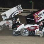 Kraig Kinser (11k) battles his father Steve Kinser Saturday night at Bubba Raceway Park in Ocala, Fla. (Al Steinberg Photo)