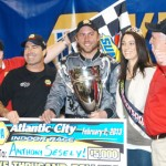 Anthony Sesely stands in victory lane after winning the Gambler's Classic three-quarter midget finale Saturday night at Boardwalk Hall in Atlantic City, N.J. (Bruce A. Bennett Photo)
