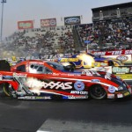 Courtney Force (near lane) launches off the line against Ron Capps in the final round of NHRA Funny Car eliminations Sunday evening at Auto Club Raceway at Pomona. (Ron Lewis Photography Photo)