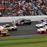 Jeff Burton (31), Greg Biffle (16) and Denny Hamlin (11) lead a pack of cars through the tri-oval at Daytona Int'l Speedway on Sunday. (Dick Ayers Photo)