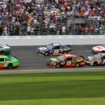 Danica Patrick (10) passes Michael Waltrip (26) to take the lead during February's Daytona 500. (Dick Ayers Photo)