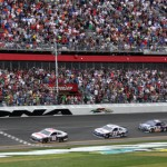 Jimmie Johnson (48) crosses the finish line ahead of Dale Earnhardt Jr. to win Sunday's Daytona 500. (Dick Ayers Photo)