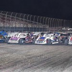 The United States Modified Touring Series field performs a four-wide parade lap prior to the 2013 feature event at Royal Purple Raceway in Baytown, Texas. (RonSkinnerPhotos.com Photo)