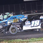 Jamie Burford (19 inside), Ryan Gustin (19 center) and John O. Whittington battle three-wide during Saturday's United States Modified Touring Series event at Royal Purple Raceway in Baytown, Texas. (RonSkinnerPhotos.com Photo)