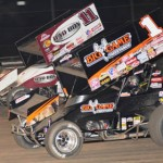 Veteran World of Outlaws STP Sprint Car Series competitors Sammy Swindell (1) and Steve Kinser battle Sunday at Volusia Speedway Park in Florida. (Julia Johnson Photo)