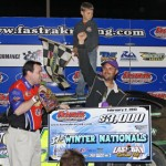 Mark Whitener celebrates in victory lane with his son after winning the Fastrak Late Model feature at East Bay Raceway Park in Gibsonton, Fla., Saturday night. (R.E. Wing Photo)