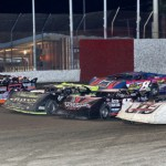 The Fastrak Late Models go four-wide to salute the fans at East Bay Raceway Park in Gibsonton, Fla., Saturday night. (R.E. Wing Photo)