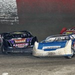 Late models make contact while battling for position during Saturday's Fastrak Late Model feature at East Bay Raceway Park. (R.E. Wing Photo)