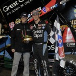 Daryn Pittman (right) stands in victory lane with car owner Kasey Kahne Friday night at Volusia Speedway Park in Barberville, Fla. (Stephen Bischoff Photo)