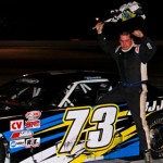 Joey Doiron celebrates after scoring the victory in the season opening Pro All Stars Series super-late-model event on Saturday at Auburndale Speedway in Winter Haven, Fla. (Amy Stratton Photo)