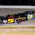Joe Boyd (5) battles Joey Doiron for the lead during the 2013 Pro All Stars Series Winter Meltdown at Auburndale Speedway in Winter Haven, Fla. The 2014 event will be held at New Smyrna Speedway. (Amy Stratton Photo)