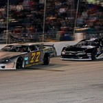 Jeff Scofield (77) tries to hold off eventual race winner Joey Doiron during Saturday's Pro All Stars Series opener at Auburndale Speedway in Florida. (Amy Stratton Photo)