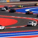 The No. 94 Turner Motorsports BMW M3 leads a pack of cars through a series of corners at Circuit of the Americas in Austin, Texas, Saturday. (Grand-Am Photo)