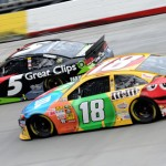 Kasey Kahne (5) battles Kyle Busch for the lead during Sunday's NASCAR Sprint Cup Series Food City 500 at Bristol (Tenn.) Motor Speedway. (NASCAR Photo)