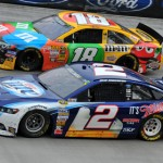 Kyle Busch (18) and Brad Keselowski battle for second place late in Sunday's Food City 500 at Bristol (Tenn.) Motor Speedway. (Michael Moats Photo)
