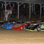 The Lucas Oil Late Model Dirt Series field goes four-wide to salute the fans prior to Saturday's feature at Brownstown (Ind.) Speedway. (Mike Ruefer Photo)