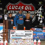 Dennis Erb Jr. stands in victory lane after winning Saturday night during Lucas Oil Late Model Dirt Series action at Brownstown (Ind.) Speedway. (Mike Ruefer Photo)