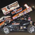 Craig Dollansky (7) battles teammate Sammy Swindell during Friday's World of Outlaws STP Sprint Car Series race at Stockton (Calif.) 99 Dirt Track. (Tom Parker Photo)