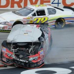 Sam Hunt's No. 18 slides to the inside after a crash as Scott Heckert drives by him on the outside at Bristol Motor Speedway Saturday. (NASCAR Photo)