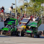 A pack of sprint cars flows down the front stretch during Sunday's TRUFUEL Must See Racing Xtreme Sprint Series event at Mobile Int'l Speedway in Irvington, Ala. (Chris Seelman Photo)